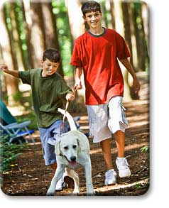 teens_walking_dog_in_park